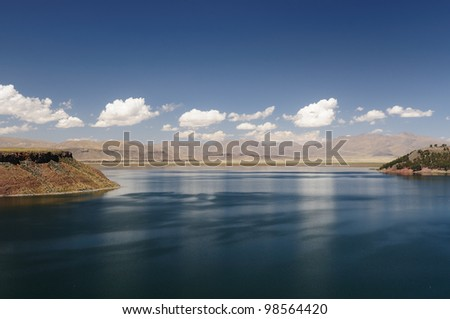 Umayo Lake which is home to a wide variety of plants and Andean waterbirds, plus a small island with vicunas ( threatened, wild relatives of Ilamas). The Lake Titicaca area in Peru. - stock photo