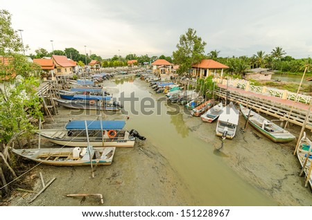 UMBAI, MALACCA - 9 AUGUST : Boats park at Umbai Jetty, Malacca, Malaysia on 9 August 2013. Umbai jetty is the main jetty entrance to the Pulau Besar, Malacca, Malaysia.