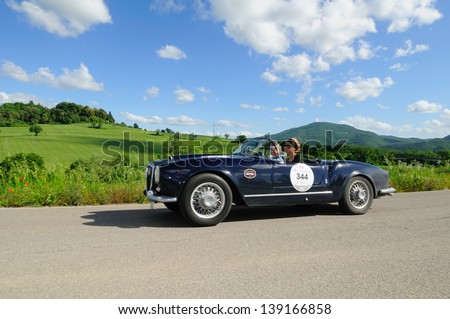 UMBERTIDE (PG) ITALY - MAY 17: Blue Lancia Aurelia B24 Spider, built in 1955, takes part to the 1000 Miglia historic car race, on May 17, 2013 in Umbertide (PG) - stock photo