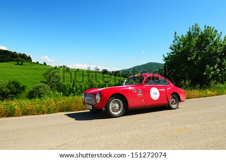 UMBERTIDE (PG) ITALY - MAY 17: Red Cisitalia 202 SC, built in 1948, takes part to the 1000 Miglia historic car race, on May 17, 2013 in Umbertide (PG) - stock photo