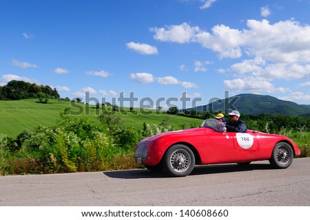 UMBERTIDE (PG) ITALY - MAY 17: Red Fiat Stanguellini 1100 sport, built in 1947, takes part to the 1000 Miglia, on May 17, 2013 in Umbertide (PG) - stock photo