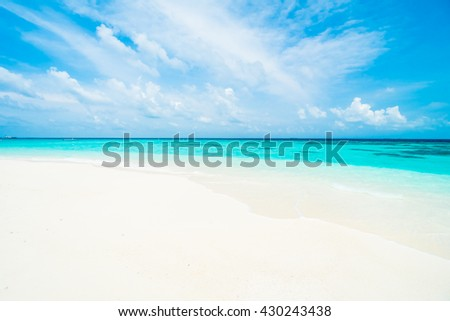 Umbrella and chair on the beautiful tropical beach and sea around hotel resort in maldives island - Boost up color Processing