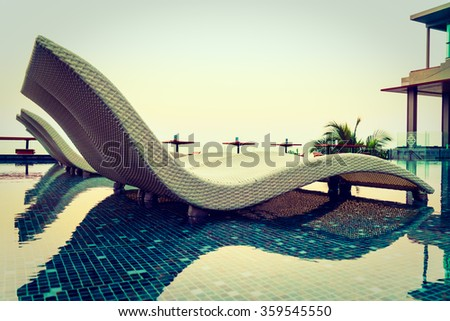 Umbrella and chair pool around beautiful luxury hotel swimming pool - Vintage Filter