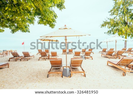 Umbrella and chair with tropical sea and beach - vintage filter