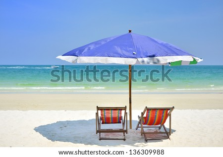 umbrella and chairs at beach over blue sky