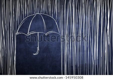 Umbrella and rain conceptual sketch on chalkboard - stock photo