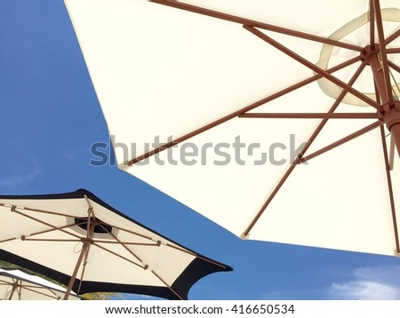 Umbrella beach and blue sky background.
