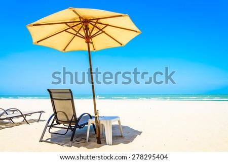 Umbrella Beach Chair On Beautiful Tropical Beach
