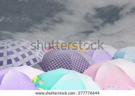 umbrella in rain sky - stock photo