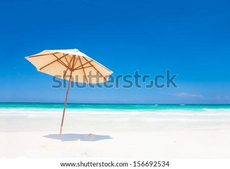 Umbrella on perfect caribbean beach in Tulum - stock photo