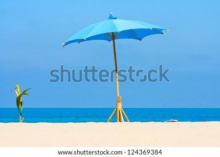 Umbrella on the beach on island Koh Phangan, Thailand. - stock photo