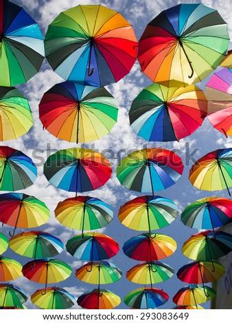 stock-photo-umbrella-on-the-sky-29308364