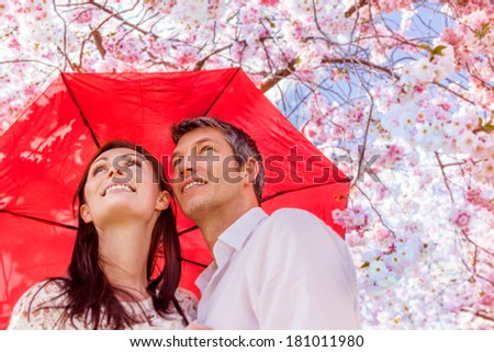umbrella safety younger couple smiling