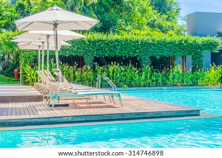 Umbrella with chair in hotel  swimming pool resort