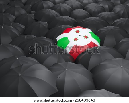Umbrella with flag of burundi over black umbrellas - stock photo