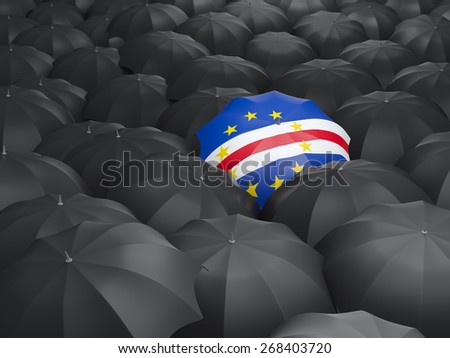 Umbrella with flag of cape verde over black umbrellas - stock photo