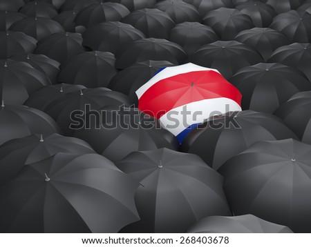 Umbrella with flag of costa rica over black umbrellas - stock photo