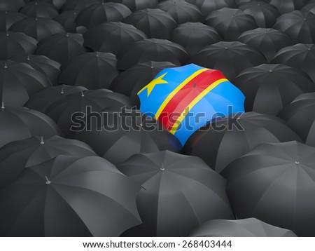 Umbrella with flag of democratic republic of the congo over black umbrellas - stock photo