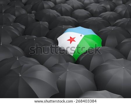 Umbrella with flag of djibouti over black umbrellas - stock photo