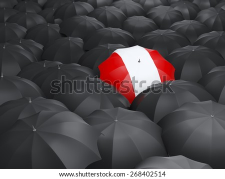 Umbrella with flag of peru over black umbrellas - stock photo