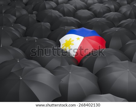 Umbrella with flag of philippines over black umbrellas - stock photo