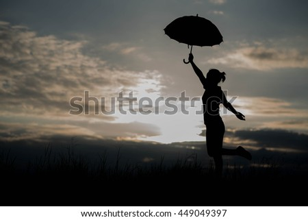Umbrella woman and sunset silhouette
