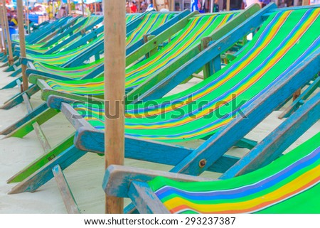 Umbrellas and beach chairs on Koh Larn, Pattaya City, Thailand.