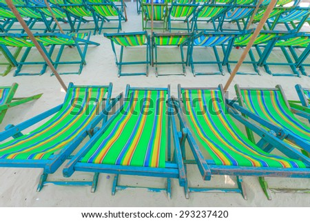 Umbrellas and beach chairs on Koh Larn, Pattaya City, Thailand. - stock photo