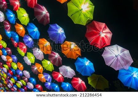 Umbrellas coloring in sky decorated - stock photo