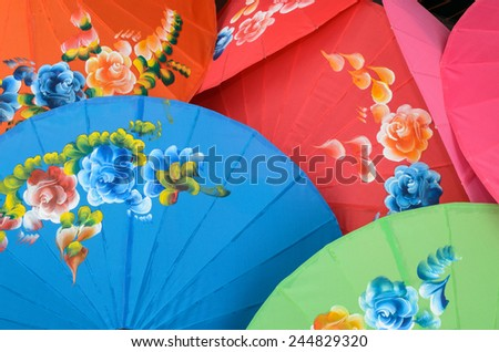 Umbrellas, handmade in Chiang Mai, Thailand. - stock photo