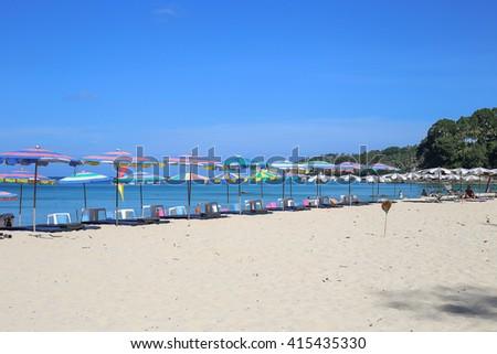 Umbrellas in a beautiful day on Surin beach in Phuket Thailand   - stock photo