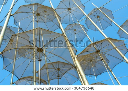 Umbrellas on the waterfront at Thessaloniki, Greece - stock photo