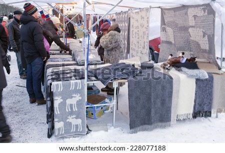 UMEA, SWEDEN ON DECEMBER 08. Christmas market, handicraft for sale on December 08, 2013 in Umea, Sweden. Unidentified persons in the market. - stock photo