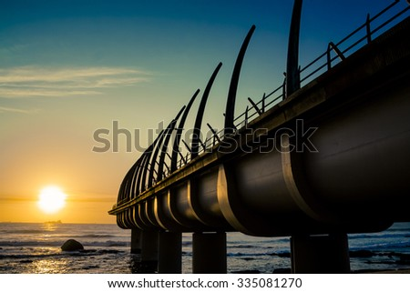 Umhlanga Pier In Durban South Africa with Sunrise over indian ocean  - stock photo