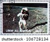 UMM AL-QUWAIN - CIRCA 1972: a stamp printed in the Umm al-Quwain shows Astronaut walks on the Surface of the Moon, Moon-landing, Apollo, circa 1972 - stock photo
