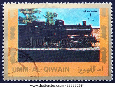 UMM AL-QUWAIN - CIRCA 1972: a stamp printed in the Umm al-Quwain shows Steam Locomotive, circa 1972