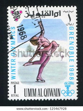 UMM AL-QUWAIN - CIRCA 1968: stamp printed by Umm al-Quwain, shows Figure Skating, circa 1968 - stock photo