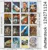 UMM AL-QUWAIN - CIRCA 1972: stamp printed by Umm al-Quwain, shows Spaceships and Astronauts, circa 1972 - stock photo