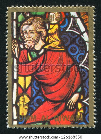 UMM AL-QUWAIN - CIRCA 1972: stamp printed by Umm al-Quwain, shows The Life of  Christ stained glass, circa 1972