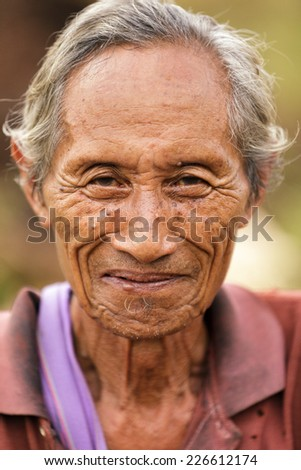 UMPHANG, THAILAND, NOVEMBER 30 : close portrait of an elderly Karen tribe man, Thai ethnicity, near the village of Umphang, north Thailand on November 30, 2012 - stock photo