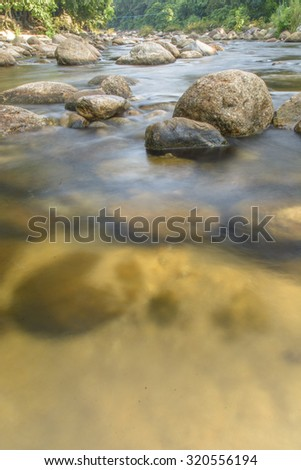 Un-focus image of Brook and rocks in the mountains at Kiriwong village, Nakorn Sri Thammarat., Thailand.