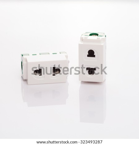 Un-installed electrical outlet on white background
