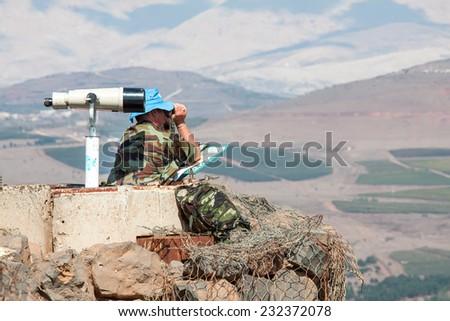 UN soldier on syrian border - stock photo