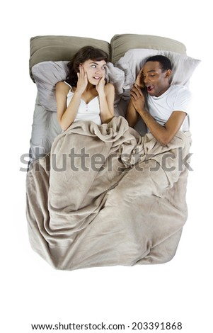 unable to sleep in bed because of snoring partner - stock photo
