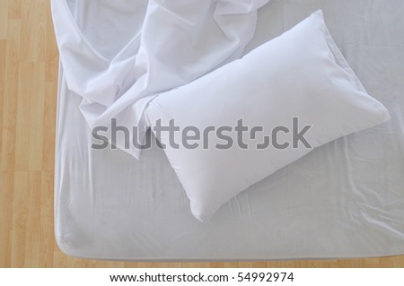 Unattended bed. - stock photo