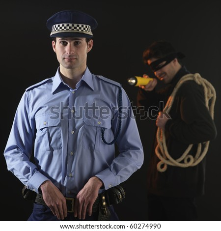 Unaware officer that a crime is being comited. black background. Square format.