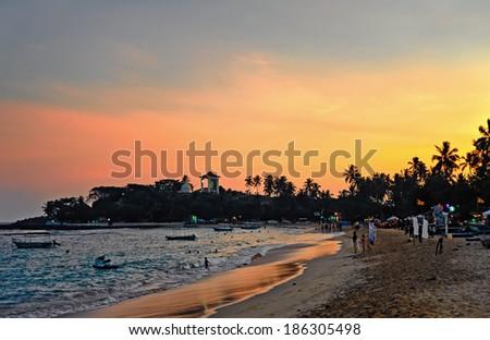Unawatuna beach at dawn in Sri Lanka - stock photo