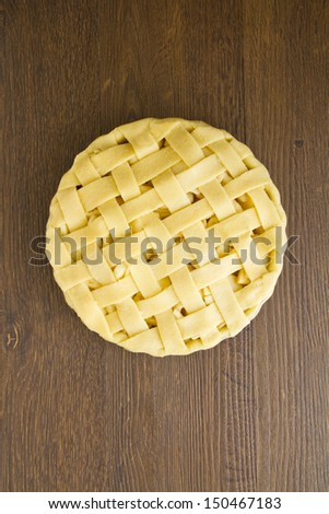 Unbaked apple pie with lattice pastry top