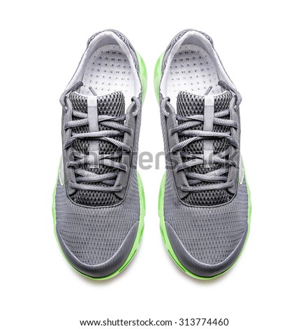Unbranded modern sneakers isolated on a white background. Top view. - stock photo
