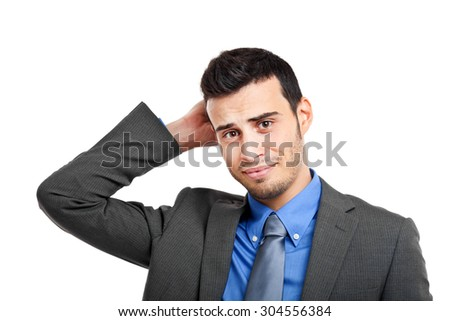 Uncertain businessman holding his head isolated on white - stock photo